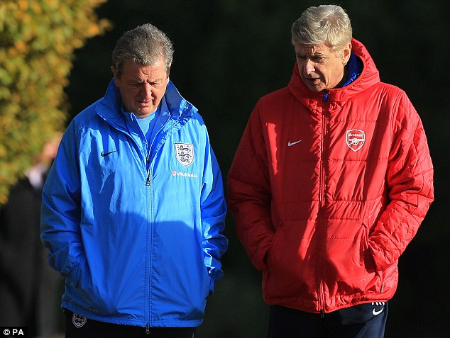 Wise words: Hodgson chats with Arsenal manager Arsene Wenger before their respective training sessions on Wednesday
