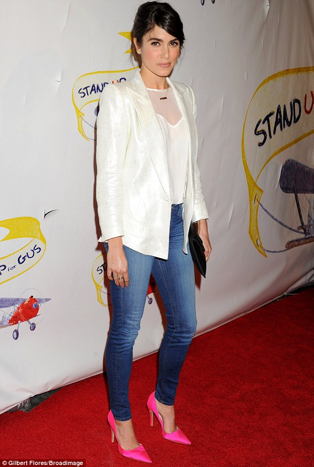 Poppin! Nikki Reed played it safe for Stand Up for Gus benefit in West Hollywood on Wednesday but added a splash of hot pink via her shoes