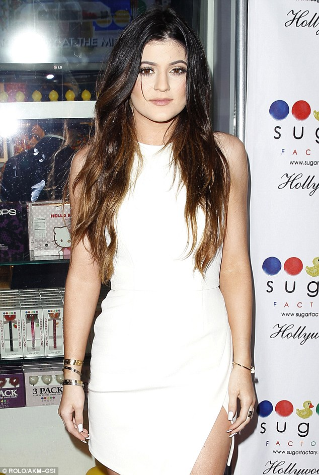 Expensive tastes: Kylie wore five pricey Cartier bangles on her arm