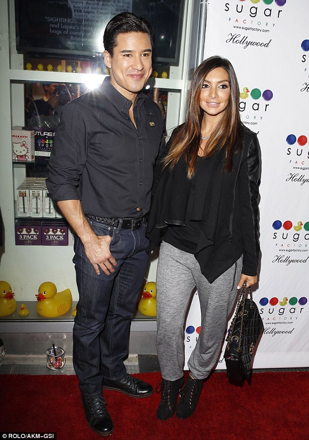 Young love: Mario Lopez and his wife Courtney Mazza arrive at the party