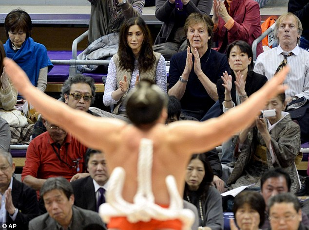 Impressed: Sir Paul McCartney takes in a sumo contest with wife Nancy Shevall in Fukoaka, Japan