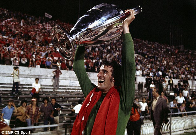 Champion: Ray Clemence celebrates with the European Cup after beating Borussia Monchengladbach