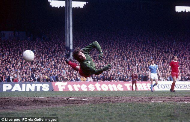 Top stopper: Clemence dives to his right to deny Manchester City a goal at Maine Road