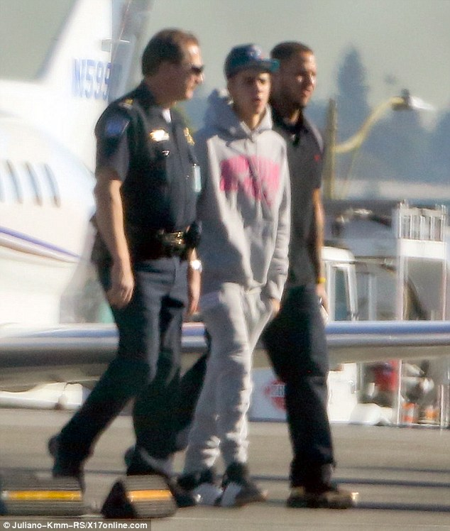 Getting processed: Justin Bieber's private jet was searched by custom officials when he arrived home to the U.S. on Wednesday at the Los Angeles International Airport