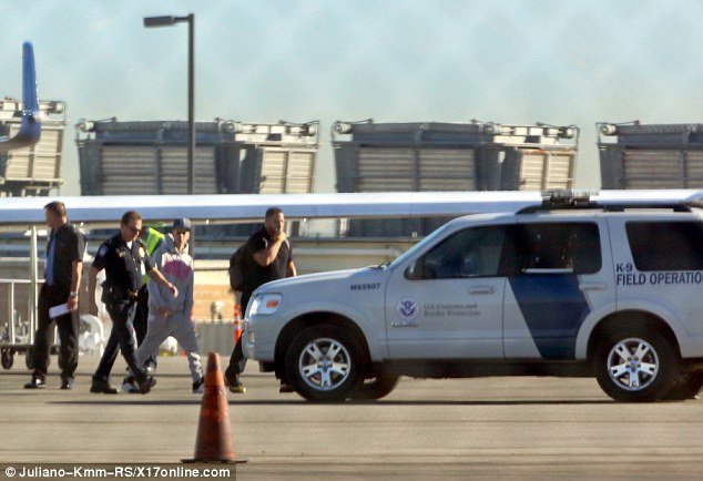 Taking it easy: The Baby singer walked to the customs field vehicle