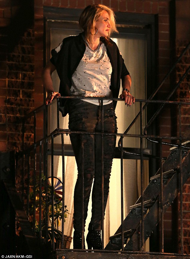 Urban: The actress was dressed in ripped skinny jeans, black studded boots and sported a messy 'do for her role as the nasty orphanage owner