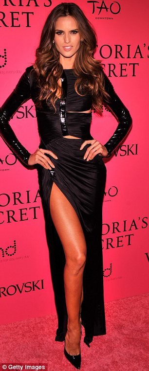 Thigh's the limit: Izabel Goulart wore a full length black dress featuring a revealing thigh high slit