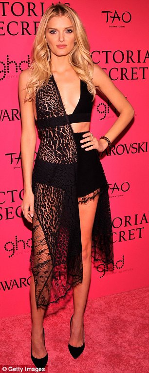 Opposites: While Behati Prinsloo was elegant in a pink dress, Lily Donaldson appeared to have forgotten half of her outfit