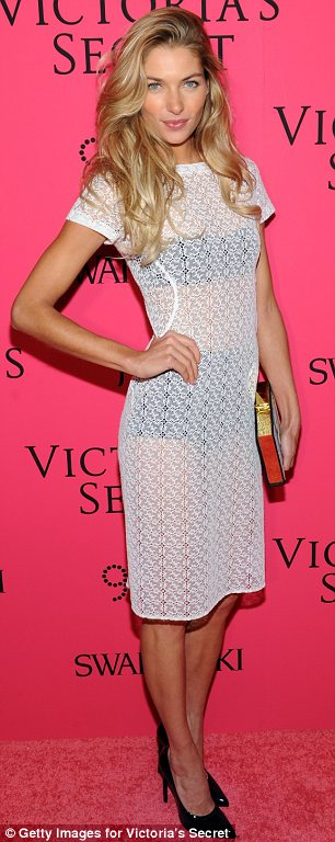 At least someone's wearing underwear: Jessica Hart's black underwear were clearly visible beneath her sheer white dress