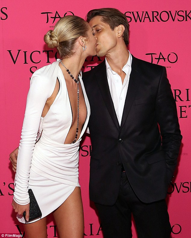 Gorgeous couple: Victoria's Secret angel Candice Swanepoel and her model boyfriend Hermann Nicoli pucker up at the after party for the 2013 Victoria's Secret Fashion Show at TAO Downtown in New York City on Wednesday night