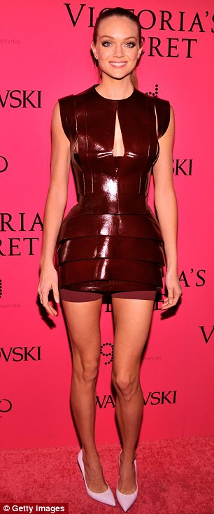 Opposites: While Carly opted for a sheer floaty number, Lindsay Ellingson chose a more futuristic design