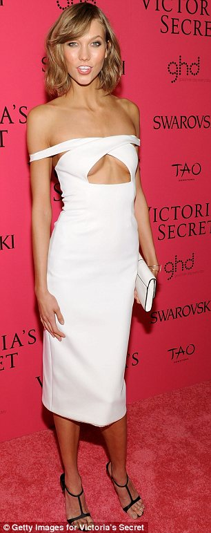 Revealing: While Candice's dress was slashed to the waist, Karlie Kloss also showed off some cleavage