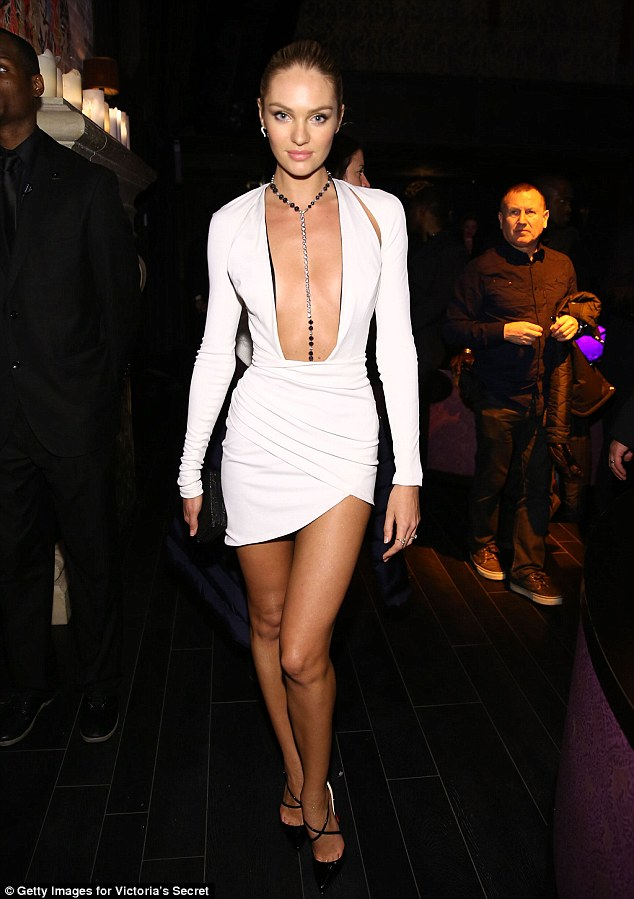 Pretty in pink: Model Candice Swanepoel looks chic in a tiny dress at the party