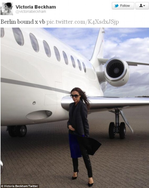 Going for gold: Victoria Beckham tweets a picture of herself as she prepared to board a plane to Berlin for the annual Bambi awards