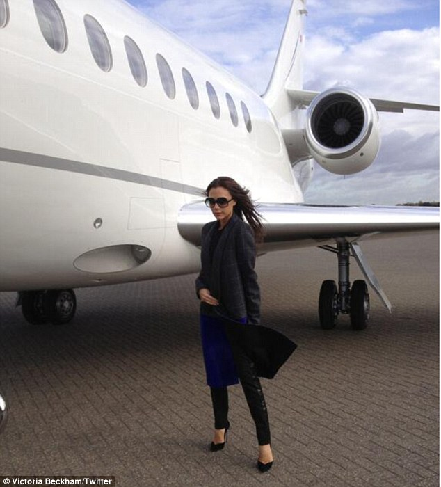 Flying in style: Victoria preparing to board her private plane to Berlin on Thursday