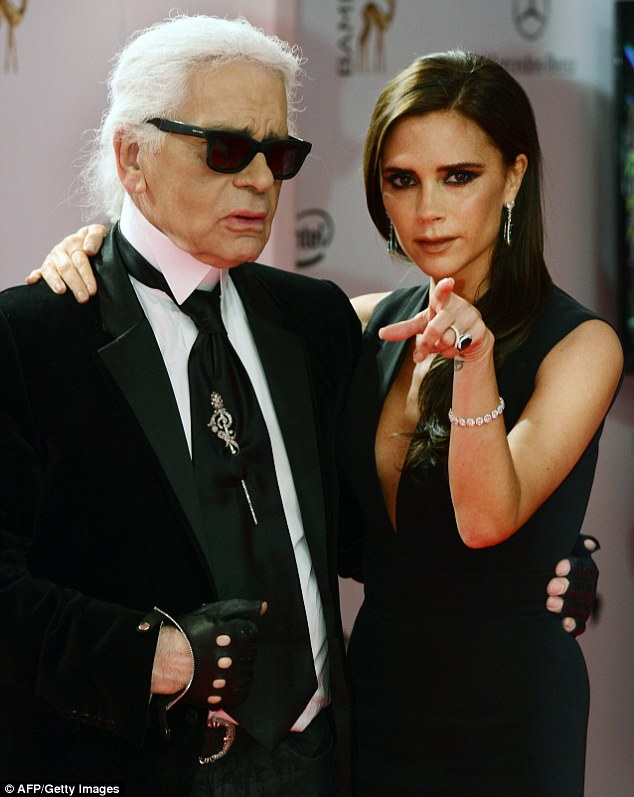 Look at the camera: Victoria is ready for her close-up as she shares the glory with Karl