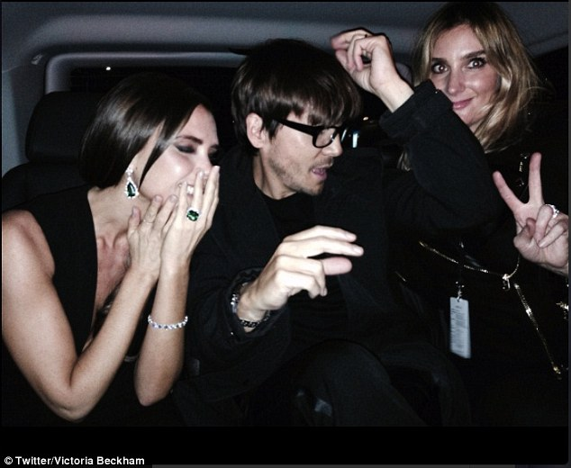 Too much fun: Victoria larking around with her hairdresser Kev Paves and her make-up artist Sarah Lucero