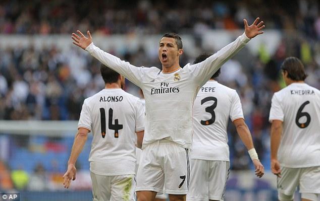 Wide open: Ronaldo is still Real Madrid's key asset, celebrating last weekend