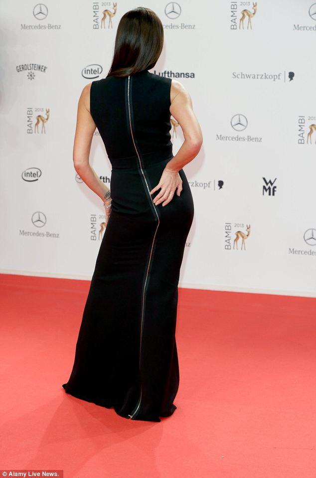 Sleek: Victoria cut an elegant figure in the floor-length, body-hugging black dress