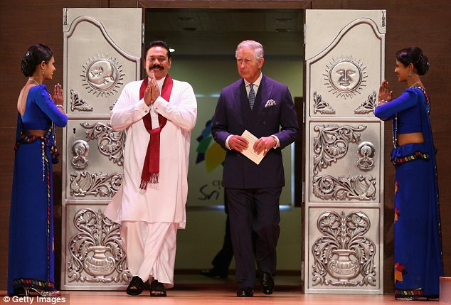 Grand entrance: President Mahinda Rajapaksa and Prince Charles walk onto the stage