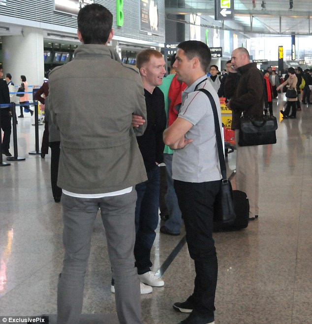 Legends: Michael Owen (right) and Paul Scholes (centre) at Hong Qiao International Airport in Shanghai