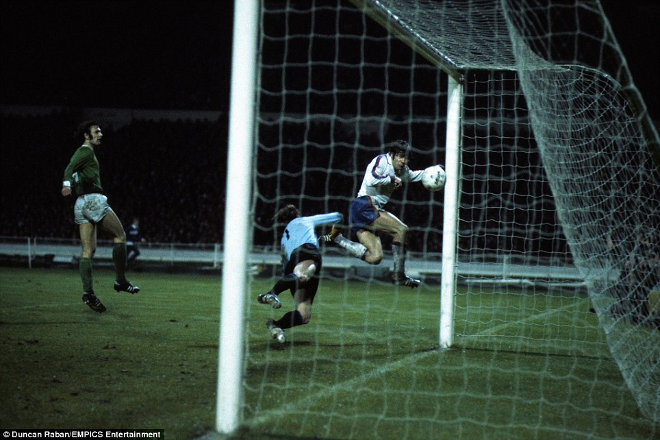 Malcolm MacDonald (right) scores for England during their International Friendly against West Germany