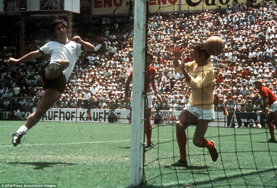 West Germany's Gerd Muller (l) fires the winning goal past England goalkeeper Peter Bonetti (r) from close range