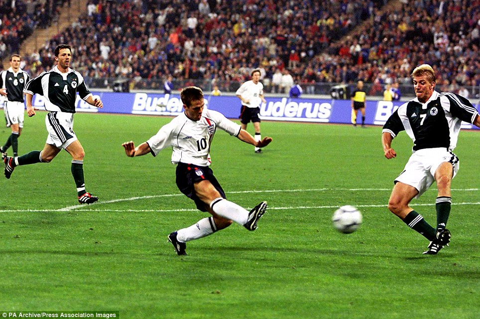 England's Michael Owen beats Marko Rehmer (right) to score his hat trick and England's fourth goal against Germany during the Fifa World Cup European Qualifying Group Nine game at the Olympic Stadium, Munich, Germany.
