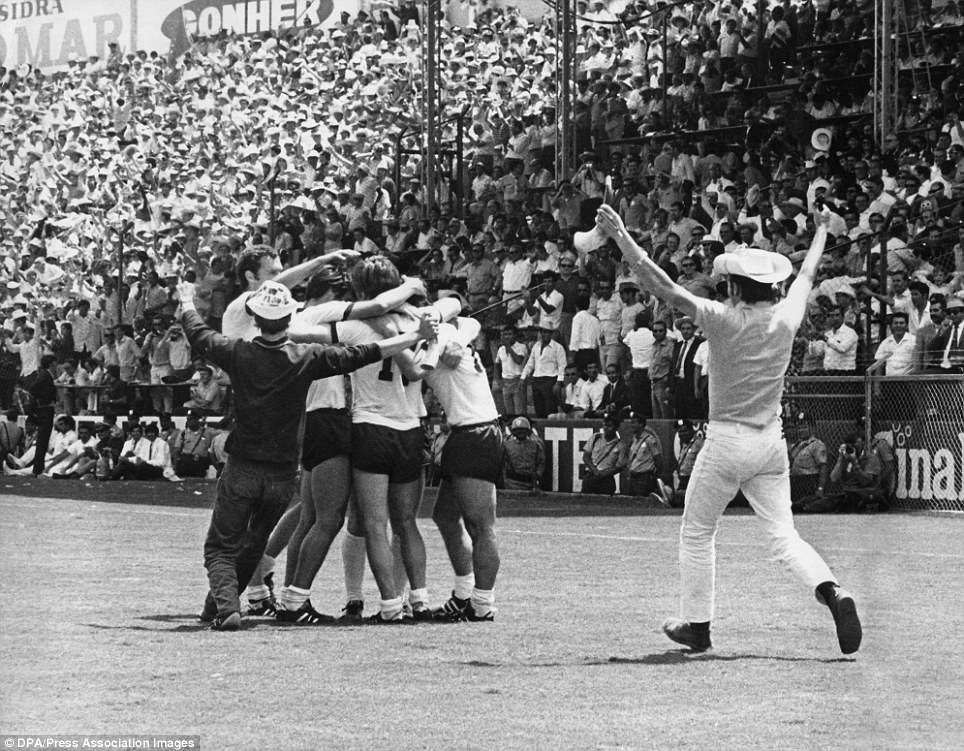 A Mexican fan runs on to congratulate the jubilant West Germany players who are celebrating Gerd Muller's winning goal in extra time