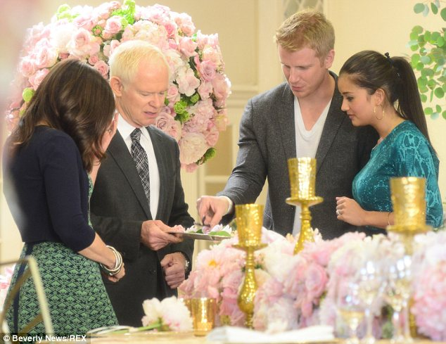 Attention to detail! The couple have lots of work to do before their January 2014 wedding and were spotted carefully examining their flower choices in Los Angeles on Thursday