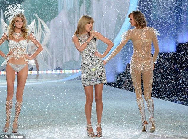 Sparkle: Taylor also received a pat on the bum but from model Karlie Kloss
