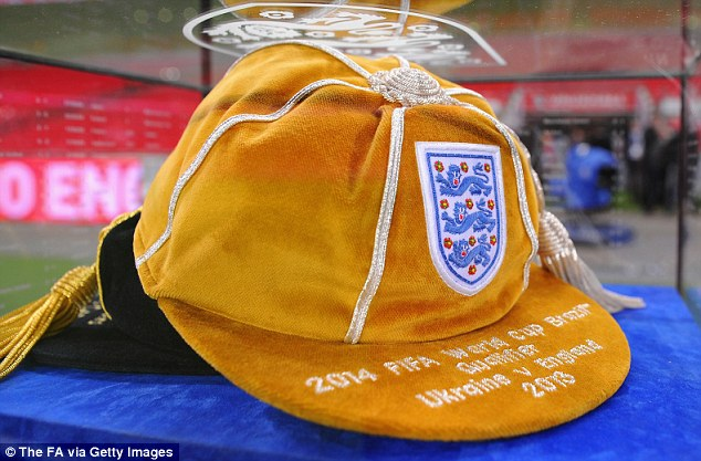 Touch: The golden cap presented to Lampard by his dad and Sir Geoff Hurst at Wembley on Friday
