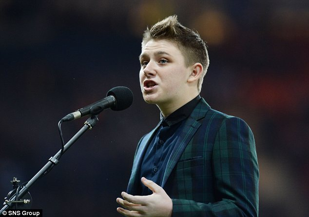 Pride: Scottish X Factor star Nicholas McDonald sports a tartan suit as he belts out the national anthem