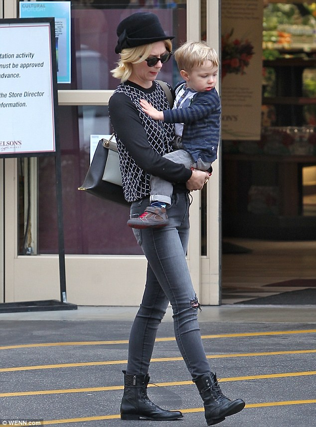 Stylish: Meanwhile, the 35-year-old actress was equally cool in pair of near-matching jeans to her son's, a black and white knit sweater, black hat and lace-up combat boots