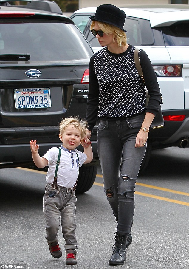 Little hipster: The Mad Men star's son was an adorable sight in a pair of worn jeans, a Henley T-shirt and a pair of braces
