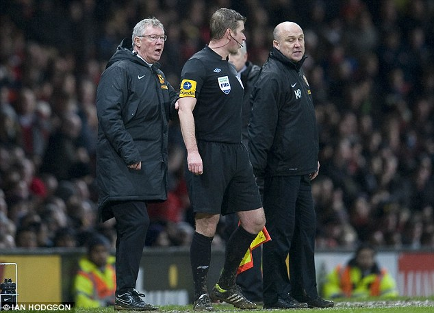 In the market: Mike Phelan (right) is interested in becoming a manager in his own right