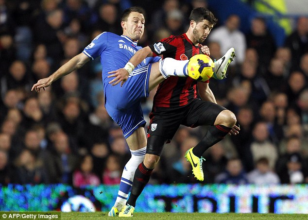 Uncertain future: John Terry (left) has been linked with a move to Roberto Mancini's Galatasaray
