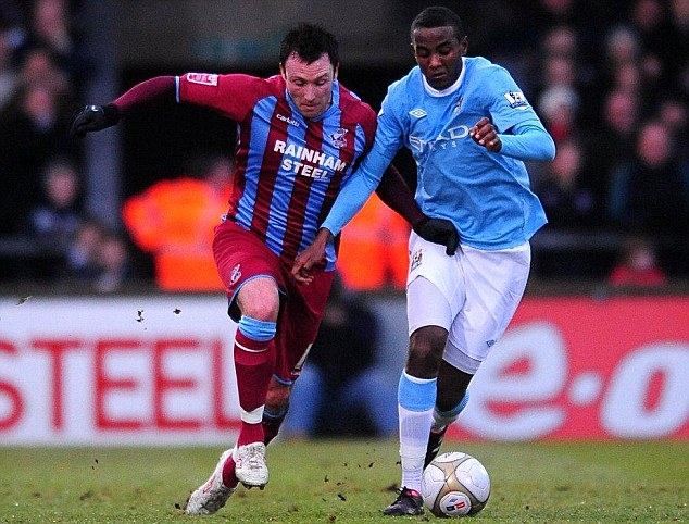 On his way: Abdisalam Ibrahim, in action against Scunthorpe in 2010, has been told he can leave Man City