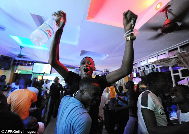 Jubilant: Fans of the Ivory Coast celebrate in Abidjan after the result