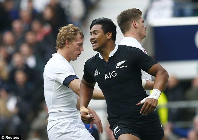 Off to a flyer: Savea wheels away after scoring the first try for the visiting New Zealand