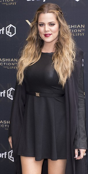 All black: Khloe opted for a flattering all black ensemble as she greeted fans at the event