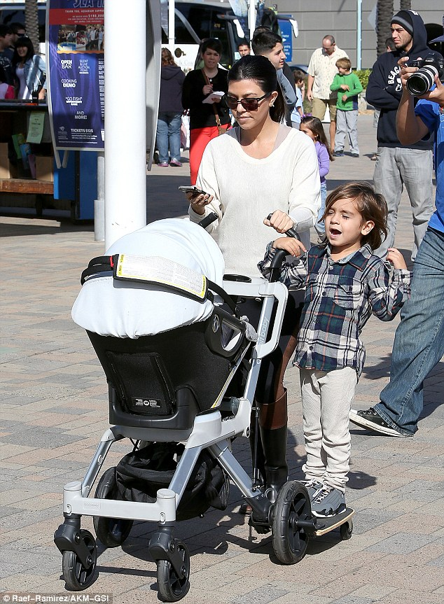 Back in LA: Meanwhile big sister Kourtney had her hands full taking son Mason and daughter Penelope to the aquarium in Long Beach on Saturday afternoon