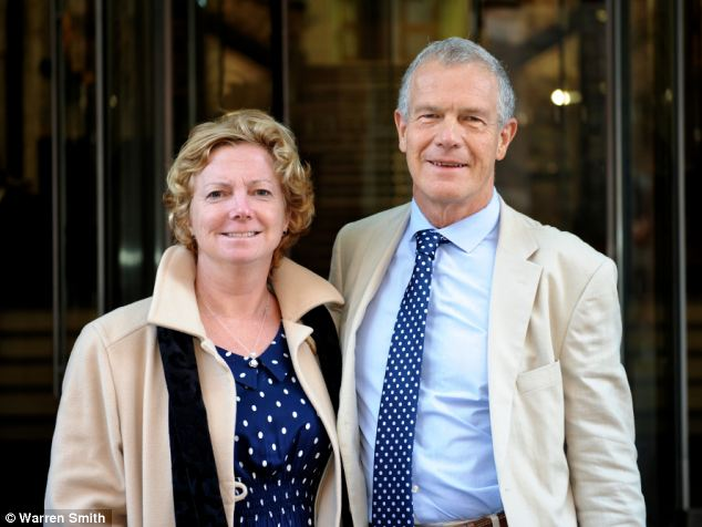 Smiles: At last week's Medical Practitioners Tribunal Service hearing in Manchester, Dr Ames and Mr Owens arrived hand-in-hand dressed in colour-matched outfits