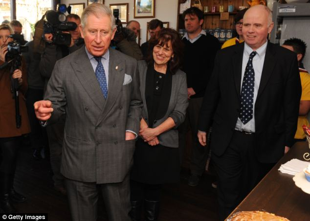 A family torn apart:  Prince Charles, meets with Barry and Margaret Mizen during a visit to the Cafe of Good Hope following the death of their son