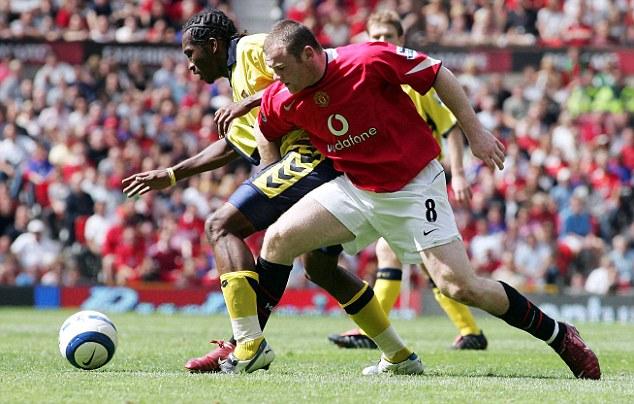 Return fixture: Now at Villa, Djemba-Djemba jostles with former teammate Wayne Rooney at Old Traffod