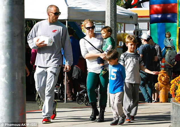 Family time: Melissa Joan Hart with her sons Tucker, Mason and Brady along with their father Mark Wilkerson seen at the farmers market in Studio City