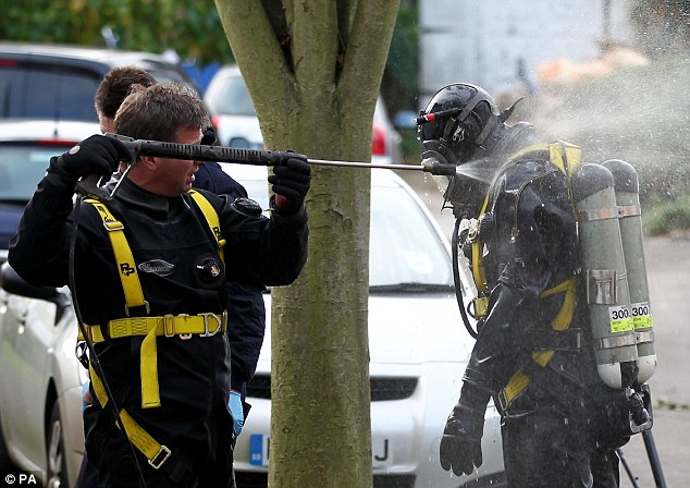 Grim task: Officers from the Underwater and Confined Space Search Team during the recovery operation