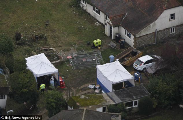 Tents: The body was found in the narrow shaft of a well outside this house on Audley Drive in Warlingham