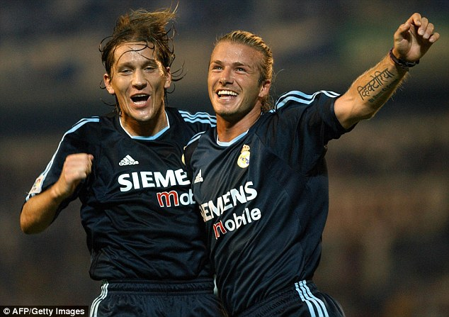 Galactico: Salgado, pictured celebrating with David Beckham, spent ten seasons with Real Madrid