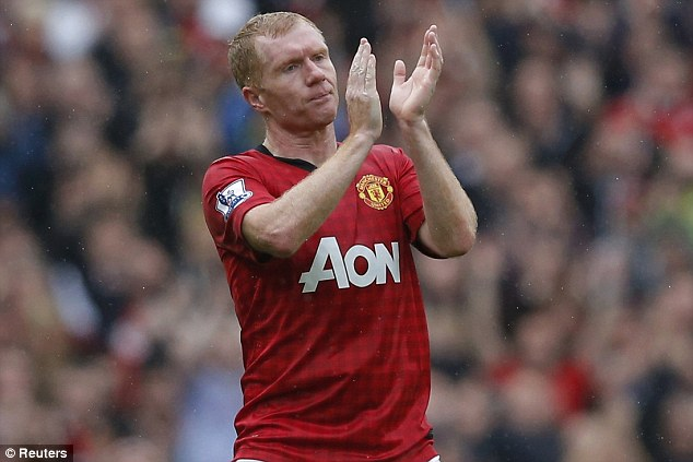 Red Devil: Scholes retired at the end of last season having made an incredible 718 appearances for Man United